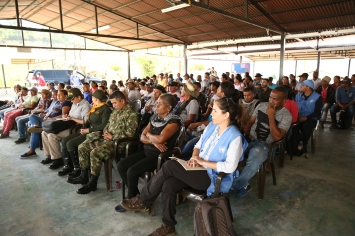 Demobilised FARC members amd local community together with the UN, and Colombian security forces.