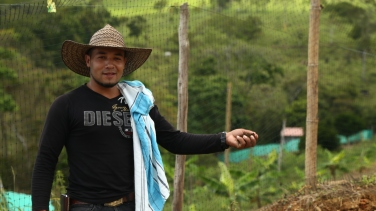 A member of the Llano Grande reincorporation zone shows the delegation some of the mini-agricultural projects being developed in the reincorporation zones. One of the principal concerns expressed during the delegation was the failure so far to provide demobilised guerrillas with any land.