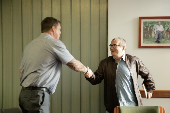 Joseph Simpson, Deputy General Secretary of the POA, meeting the President of the FARC political party, Rodrigo Londoño