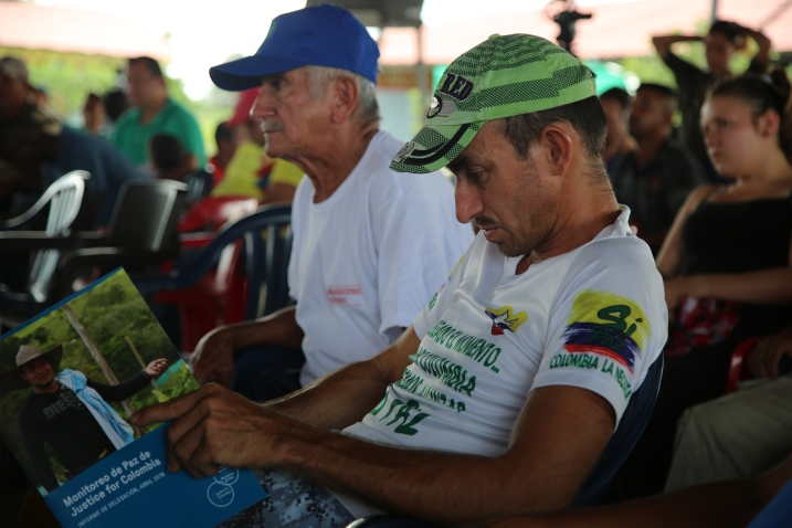 A member of the FARC reincorporation zone reads the recently published JFC Peace Monitor report